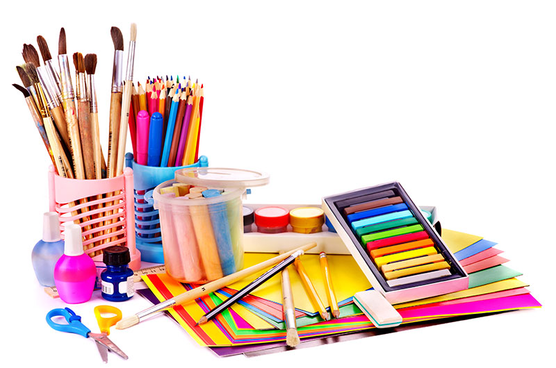 Variety of different art supplies on a white background, displaying a combination of creativity