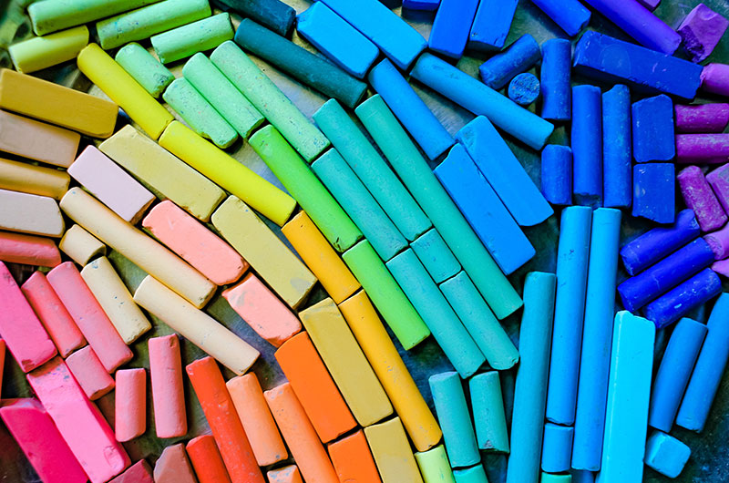 Various different colored chalk, representing LGBTQ+ affirmative mental health
